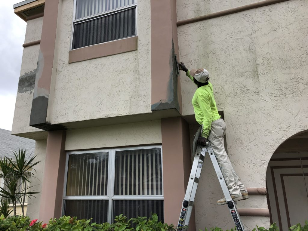 Stucco pro in action during a installation on a second floor home.